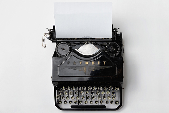Manual typewriter on white