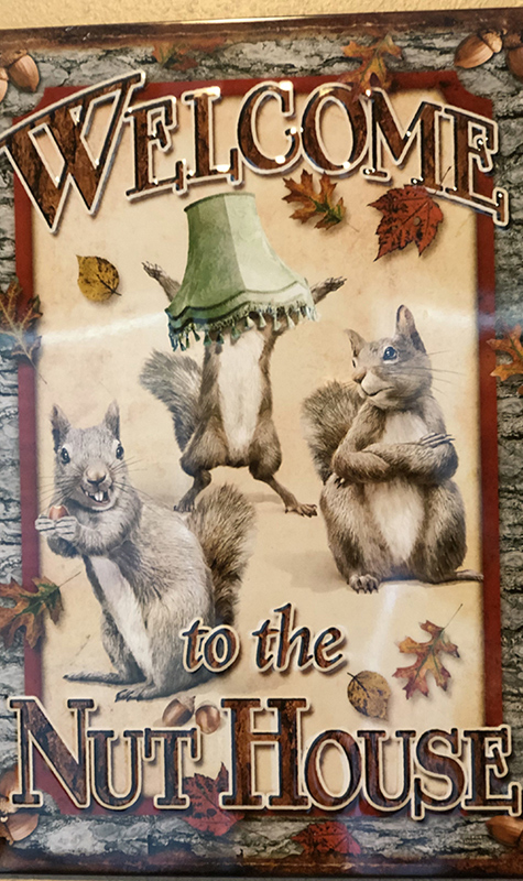 """""""Welcome to the Nut House"""" squirrels sign."""