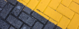 Bricks - one side painted black...the other side, yellow.