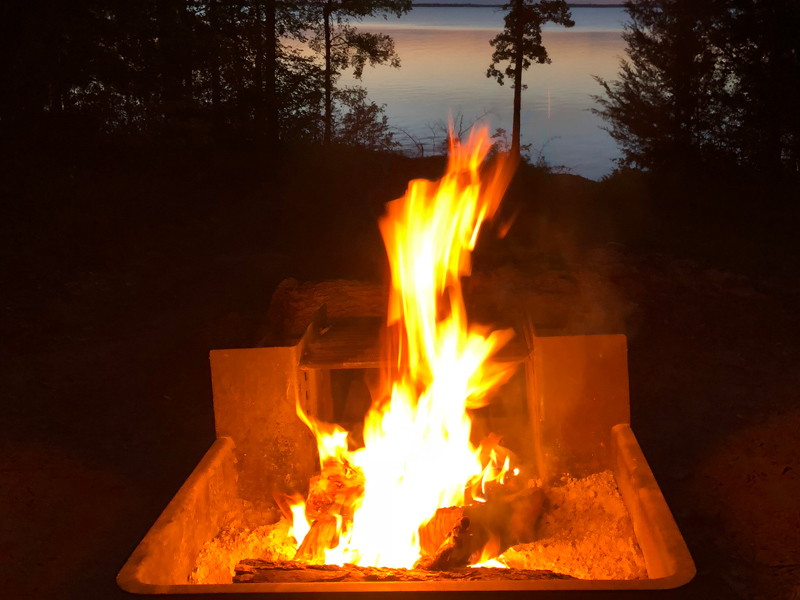 Campfire with the lake in the background.