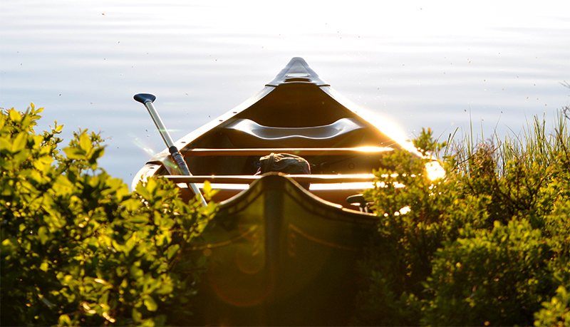 Canoe at the side of a lake