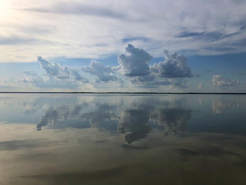 Clouds reflected on Jim Chapman Lake.