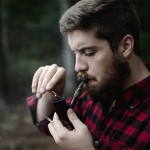 Guy lighting a pipe