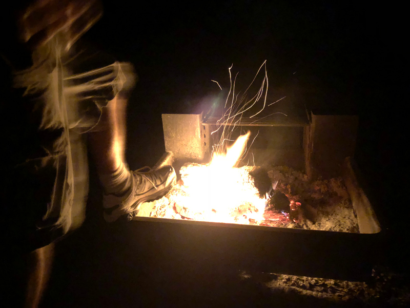 Kicking fire.