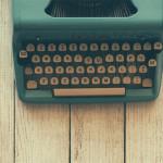 Manual typewriter and notebook