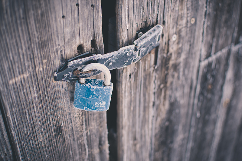 Padlock on barn doors