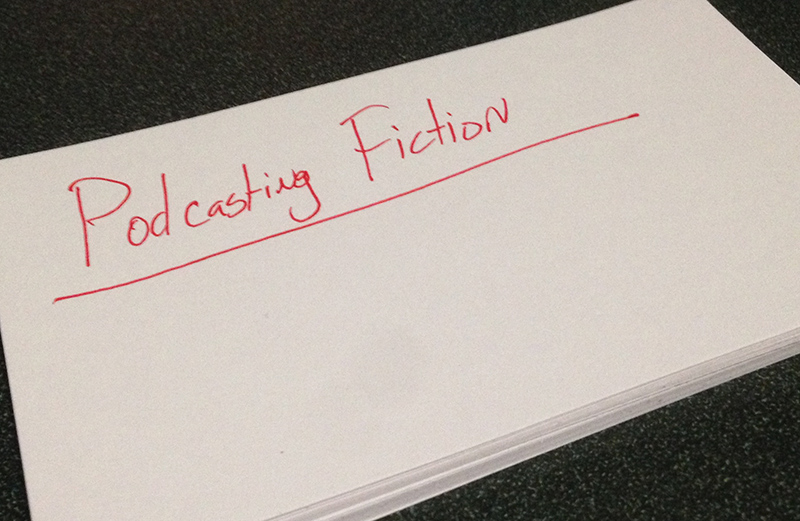 """Stack of Note Cards. Top One Reads """"Podcasting Fiction"""""""