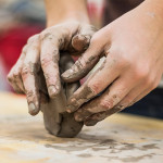 Hands sculpting clay