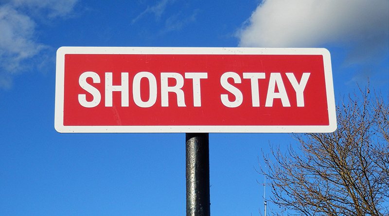 Sign reading SHORT STAY