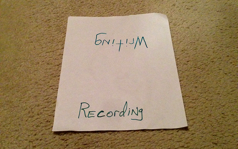 "Sign reading ""Writing"" and ""Recording"" on opposite sides."