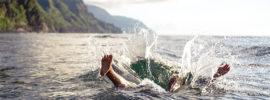 Person splashing down into a lake.