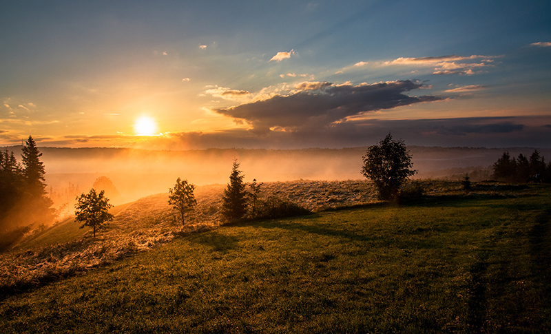 Sunrise over a hill.