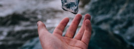 Hand tossing a stone in the air